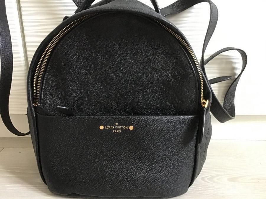 Louis Vuitton sac à dos Sorbonne en cuir noir embossé. Excellent état