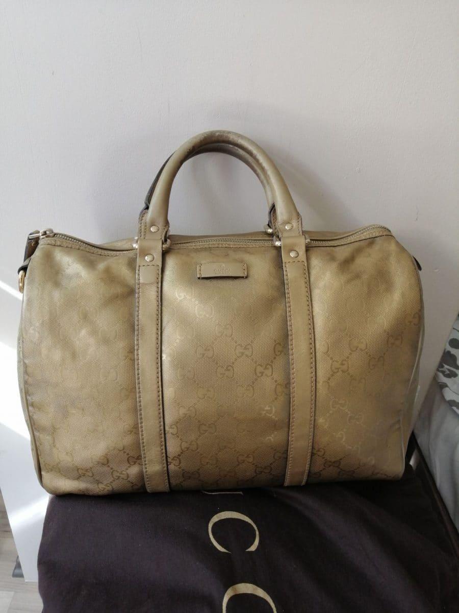 Superbe sac Gucci Boston en cuir et toile monogramme doré. Très bon état